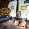The hut features an indoor woodpile.- Ludlow Hut