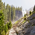 The Mist Trail leading up to a high flow Vernal Falls.- Vernal Falls Hike via Mist Trail
