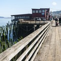 View looking east along the trolley line along the Astoria Riverwalk Trail.- Astoria Riverwalk Trail