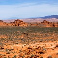 The rocks of Valley of Fire rise up out of the green desert like Martian mountains.- Valley of Fire State Park
