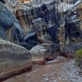 Large rock formation between first and second slot sections.- Willis Creek Slot Canyon