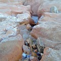 Small waterfall near the trailhead.- Willis Creek Slot Canyon
