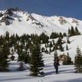 Beginning the traverse around the lower east-facing slopes.- Lassen Peak: Southeast Chutes Backcountry Ski