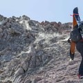 Navigating around fumaroles en route to the summit ridge.- Lassen Peak: Dirty Martini Chute Backcountry Ski