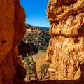 Rock formations frame the surrounding vistas.- Arches Trail