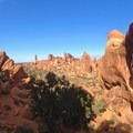Double O Arch viewed from the west.- Devils Garden + Primitive Trail