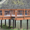 Fishing and picnic deck.- Chimney Rock Campground