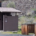 Vault toilets at Chimney Rock Campground.- Chimney Rock Campground