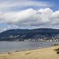 Looking north from Third Beach toward the city of West Vancouver.- Stanley Park