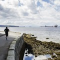 A runner rounding Ferguson Point on the sea wall path.  - Stanley Park