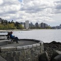 A sea wall seating area looking south toward Second Beach and downtown Vancouver.- Stanley Park