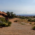 One of two trailheads for the Broken Arch Trail in the campground.- Devils Garden Campground