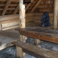Sleeping loft and table inside the shelter.- Timpanogas Shelter