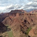 West facing view from Big Pan looking down the Colorado River.- South Kaibab + Bright Angel Trails