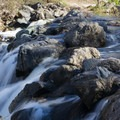 The San Diego River tumbles over a crumbling wall.- Mission Trails Regional Park, Visitor Center Loop