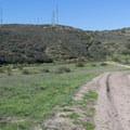 A mountain biker on Grasslands Crossing Trail.- Oak Canyon + Grasslands Crossing Loop, Mission Trails Regional Park