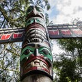 Authentic totems in the park depict the rich history of native people in the area.- Capilano Suspension Bridge Park