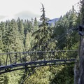 The Cliff Walk features a bold semi-circlular stretch that takes visitors away from the rock face using a dramatically curved cable-span.- Capilano Suspension Bridge Park