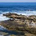 The rocks off the seawall are popular for sunbathing.- Children's Pool