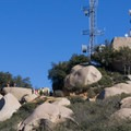 Hikers wait in line for a photo at Potato Chip Rock.- Potato Chip Rock, Mount Woodson