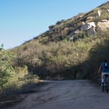 Mountain biker along the lower section of the trail.- Potato Chip Rock, Mount Woodson
