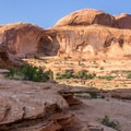 The arches come into view just after the first set of chains.- Corona Arch Trail