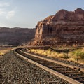 Crossing the tracks near the trailhead.- Corona Arch Trail
