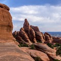 The formations around the arch are fantastic.- Klondike Bluffs Trail + Tower Arch Hike
