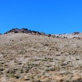Rock features break up the rolling, grassy hills on either side of the recreation area.- Water Canyon Recreation Area