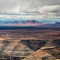 Monument Valley in Arizona seen in the distance.- Muley Point on Cedar Mesa