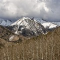 The La Sal Mountains provide a stark contrast to the red rock desert around Moab.- La Sal Mountains Scenic Loop