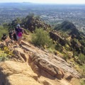 The trail follows a ridge up to the summit.- Cholla Trail