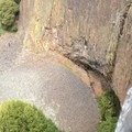 Decomposing columnar basalt under a lava cap and waterfall.- Fern Falls + Coal Canyon Falls