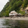 Old and new houses line the banks of Vashon Island throughout Colvos Passage.- Vashon Island Circumnavigation