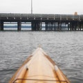 A kayaker approaches the ferry terminal on the north side of Vashon Island.- Vashon Island Circumnavigation