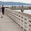 People walk and fish along the Dash Point Pier.- Vashon Island Circumnavigation
