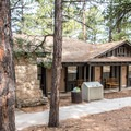 The motel section is tucked in the woods and near the canyon rim.- Grand Canyon Lodge, North Rim