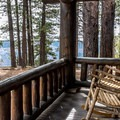 The deluxe cabins have porches, rocking chairs, and fireplaces.- Grand Canyon Lodge, North Rim