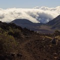Descending into the valley as the clouds move in and out.- Sliding Sands Trail: Haleakalā Visitor Center to Erosional Valley Floor