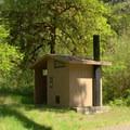 Vault toilet in Secret Campground.- Secret Campground