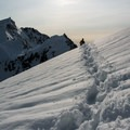 Plunge stepping back down to base camp.- Sperry Peak