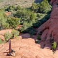 Trail markers keep you on track as the path crosses sandstone.- Lava Tube Loop