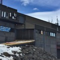Desolate summit lift building.- Mount Bachelor: Spring Lap