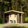 Vault toilets in Packard Creek Campground.- Packard Creek Campground