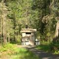 Vault toilet.- Packard Creek Campground