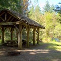 Multiple person site with covered picnic area.- Packard Creek Campground