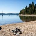 A beautiful beach sits just below Crescent Lake Campground.- Crescent Lake Campground