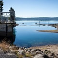 The dam that diverts some of Crescent Lake's water for irrigation is also the walkway to Crescent Lake Resort.- Crescent Lake Campground