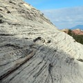 Pick your way up the sandstone slab to get to the climbing route.- North Guardian Angel Climb