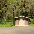 Vault toilet located near the boat launch. - Packard Creek Day Use Area